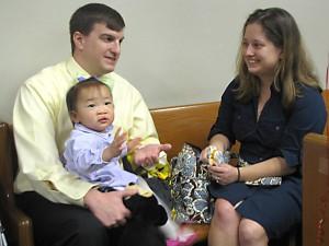 Patrick and Amanda O'Neill, of Tucker, used a private agency to adopt Morgan, 20 months old, from China. The couple plans to adopt again next year.