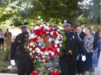 A large wreath was placed at the memorial wall in front of the courthouse that lists the names of the fallen officers