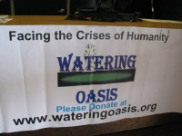 A banner invites visitors to the Lithonia facility to contribute to Watering Oasis' projects.