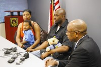 Jermaine and Nina Harrison with their son Evan talk with DeKalb County Police Chief Cedric Alexander about the experience of their 2-year-old son being shot. Photo by Daniel Beauregard