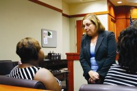 DeKalb County Superior Court Judge Stacey Hydrick chats with the mothers of two girls enrolled in her SMILE program. Photo by Daniel Beauregard