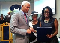 "From left, Rep. Hank Johnson, Pastor Deborah W. Tuff and Antoinette Tuff. Antoinette Tuff received a proclamation from Johnson who said she ""may very well have saved our community and the nation from yet another unspeakable national tragedy involving innocent children."" Photo provided"