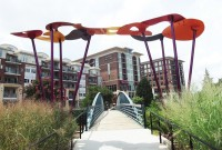 Whimsical arch gracing the pedestrian bridge over Reedy River. Photo by John Hewitt