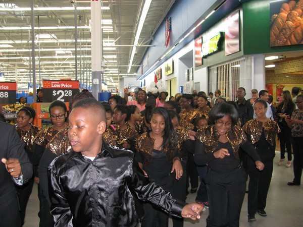 Students from Lithonia Middle School Show Choir join in the celebration leading to the ribbon cutting for the new Walmart.