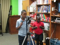 From left, Adrian Knox-Price films the WJES program as Jaela Calvin looks on.