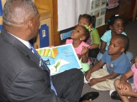 State Sen. Emanuel Jones reads to children at Alpha Academy in Decatur. Photos by Andrew Cauthen
