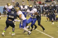 Chamblee quarterback Kendrew Wynn looks for a receiver down field while Redan defenders pressure him.