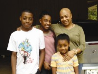 Dee Dee Murray, right, embraces her children, from left, Enam, Senaite and Hadassah. Murray was diagnosed with breast cancer in June. Photos provided