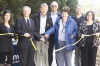 Dunwoody city officials and residents cut the ribbon to celebrate the completion of the city's fifth mile of sidewalk paving along Happy Hollow Road. Photos by Carla Parker