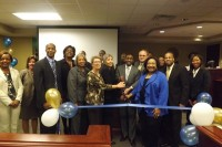 Interim DeKalb County CEO Lee May (center) along with DeKalb County commissioners, judges and other elected officials cut the ribbon to the renovated DeKalb County Recorders Court.