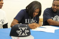 Brea Elmor signs her letter of intent to the University of Memphis Photo provided