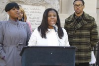 Mary-Pat Hector (center) speaks during a media conference about her campaign against gun violence. Photo by Carla Parker
