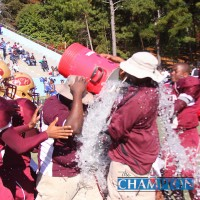 Tucker Middle players douse the coaches after their 22-20 win over Chapel Hill Panthers. Photos by Travis Hudgons