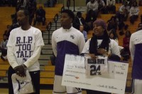 The Miller Grove boys' basketball program unveiled its fifth consecutive state championship banner Dec. 3. The program also paid tribute to its fallen teammate, Terrell Coleman, unveiling a poster with his No. 24 jersey number and presented his parents, Willie and Raeshones Coleman (far right), with his jersey.
