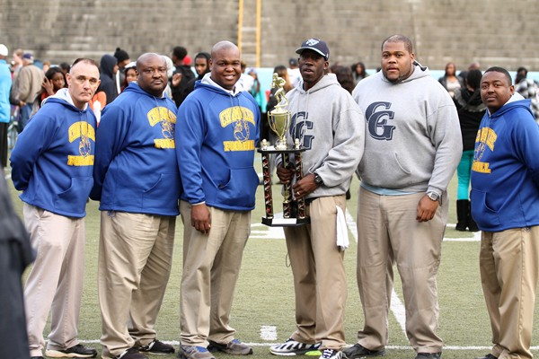 From left, Chuck Atkinson, Ramond Mosley and Allen Johnson, Chamblee; Head Coach Jermaine Smith and Lawrence Smith, Cedar Grove; and Thomas Maxwell, Chamblee, coaches of the West team, pose with the winning trophy after the West defeated the East team 28-23.