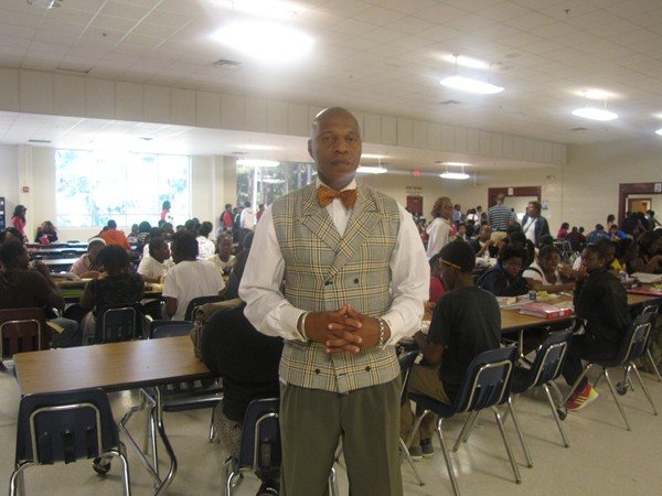 The students behind Towers Principal Ralph Simpson will be wearing school uniforms in January. File photo
