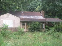 The county recently created a foreclosure registry in an effort to combat blight. Owners of houses like this one, in unincorporated DeKalb County, will be required to register their properties with the county or risk facing fines. File photo