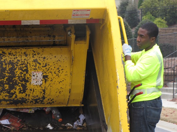 Interim DeKalb County CEO Lee May rode along with sanitation workers Nov. 22 and picked up trash for several hours.