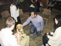 Somnath Das enjoys a study break with Henry, the Canine Assistants' spokesdog. Photos by Andrew Cauthen