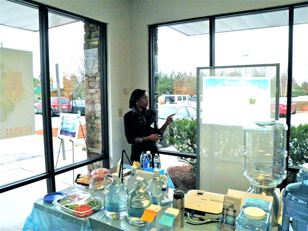At a recent tasting event at Vitamin Unlimited in Lithonia, Robertson explains benefits of her water. Photos provided.