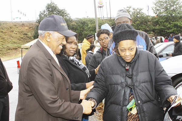 """DeKalb NAACP President John Evans and HUGLIFE manager """"Mama FlyStyle"""" greet people and help with line management."""
