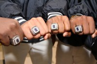 Redan baseball players show off their championship rings. Redan players, along with Southwest DeKalb players, will try to help their coaches reach milestone wins this season. Photo by Travis Hudgons