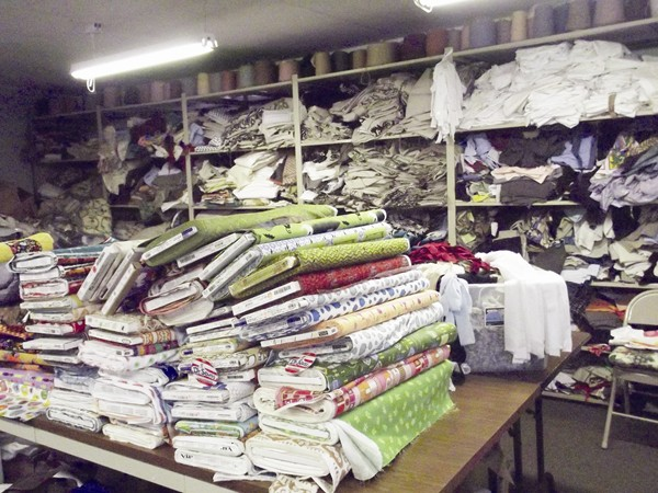One room at Weavers Warehouse is filled with donated bolts of fabric and clothing.