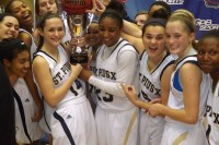 Seniors Anna Nelson, left, and Jasmine Carter hold the trophy after St. Pius defeated Buford 48-45 in the Class AAA state title game. Photos by Carla Parker