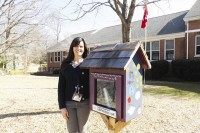 Kelly Stopp, a second-grade teacher at Winnona Park Elementary School in Decatur, was surprised by students and parents with this Little Free Library as an end-of-the-year class gift. She said it became a symbol for the school and a great way to catch up with reading and meet new neighbors. Photo by Marta Garcia