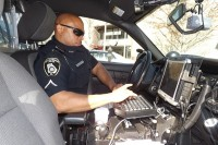 Officer C.J. Gresham, who has been with the Decatur Police Department since 1997, types up a police report.