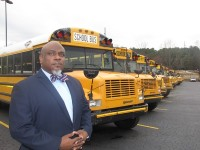 Even during his four years as a bus driver, Bernando Brown, now a DeKalb County School District dispatch supervisor, said he always dressed up for the job. Photo by Andrew Cauthen