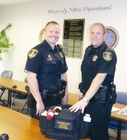 When Dunwoody Police officers Anthony Stallings and Mark Stevens rolled out on a call March 24 they found two children desperate for a diaper change. The officers, both fathers, said their paternal instincts kicked in. Both officers received Dunwoody diaper bags equipped with everything they need in case of another diaper emergency. Photo by Marta Garcia