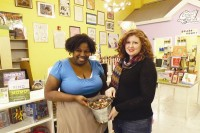 From left, Little Shop of Stories Kimberly Jones and Shelley Wunder-Smith holding the penny donation jar.