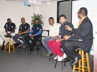 A panel of fathers discusses the challenges of fatherhood during an event sponsored by the DeKalb Department of Family and Children Services. Photo by Andrew Cauthen