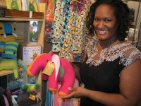 Beehive owner Malene Davis shows items from Mr. Sogs Creatures, one of the stores within a store at Beehive. Photo by Kathy Mitchell