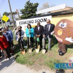 From left with shovels, Paula Tate, Valerie Morgan, Commissioner Larry John and owner Salman Badruddin stand in front of the planned location of the Wesley Chapel Road Dunkin' Donuts. Photo by Travis Hudgons
