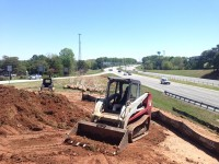 County employees are partnering with the Stone Mountain Community Improvement District to beautify an area located off Highway 78 and Mountain Industrial Boulevard. Photo by Daniel Beauregard