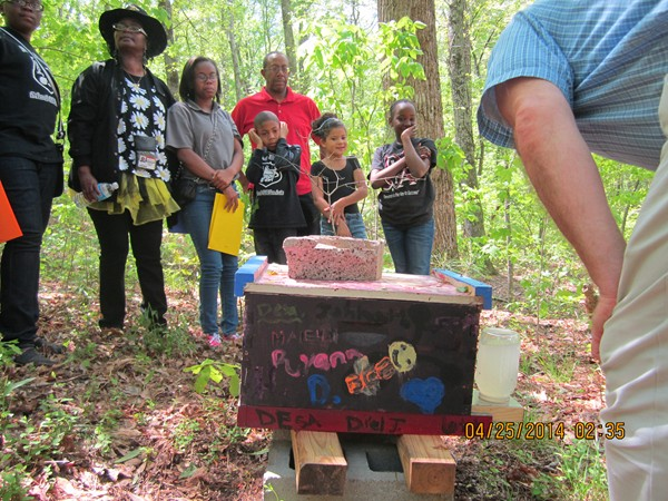 David Shipp, a local beekeeper for DeKalb Elementary School of the Arts' Beekeeping Club, demonstrates a bee box at Panola Mountain State Park. Photo provided