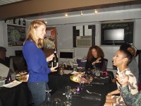 Juliette Tafel representing Bacco Wine Distributors, talks about one of the wines served at the Purple Corkscrew's wine and food pairing dinners. Photos by Gale Horton Gay