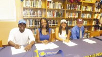 From left to right, baseball player Kelvin Wimbish signed with Albany State, Ayauna Ellis received a volleyball scholarship to Fort Valley State, Kaylin Roman received a tennis scholarship to Johnson C. Smith and Jason Davis is heading to Morehouse to play baseball.