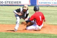 Dunwoody's Chase Hawkins (no. 1) slides to second base.