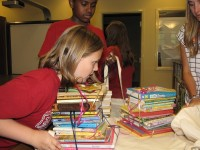 Colson Dennis prepares to take donated books to students at the Global Village Project in Decatur.