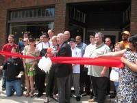 Marshall joins city officials and supporters for the May 20 ribbon-cutting.