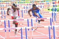 Stephenson sophomore Denzel Harper, right, finished second in the 300-meter hurdles. He won a gold medal in the long jump.