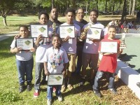 "Pictured some of the students who competed in the National Junior High Championship and the Beau Hardeman Invitational Chess Tournament. From left back row, Essig Kemp, Barry Gray; middle row, Collin Laster, Leon ""T.J."" Guthrie, Treveon Cheeley, Richard Slaton, Jr.; front row, Jacari Ford, Bryce Cowins."