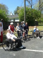 Residents of Peregrine's Landing gather after delivering Meals on Wheels.