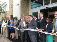 Brookhaven Mayor J. Max Davis and other officials cut the ribbon to officially open the Hyatt Atlanta Perimeter at Villa Christina.