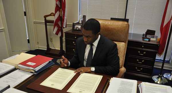 Interim DeKalb County CEO Lee May signs an executive order creating a task force to explore DeKalb County's government and operations. Photo provided