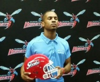 Former Arabia Mountain High School athlete Jonathan Jones received a football and track scholarship to Delaware State. Jones received the scholarships less than four months after his father, Addison Jones, passed away.