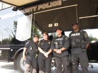 DeKalb Police officers stand outside a SWAT vehicle during National Night Out. Photos by Andrew Cauthen